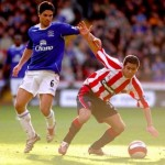 Everton's Mikel Arteta and Sheffiled United's Ahmed Fathi battle for the ball