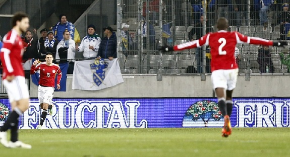 Egypt's Gedo (center) reacts after scoring against Bosnia.