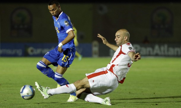 Cape Verde's Nuno Rocha, left, is challenged by Tunisia's Aymen Abdennour, right, during the African Cup of Nations Group B soccer match between Cape Verde and Tunisia in Ebebiyin, Equatorial Guinea, Sunday, Jan. 18, 2015. (AP Photo/Themba Hadebe)