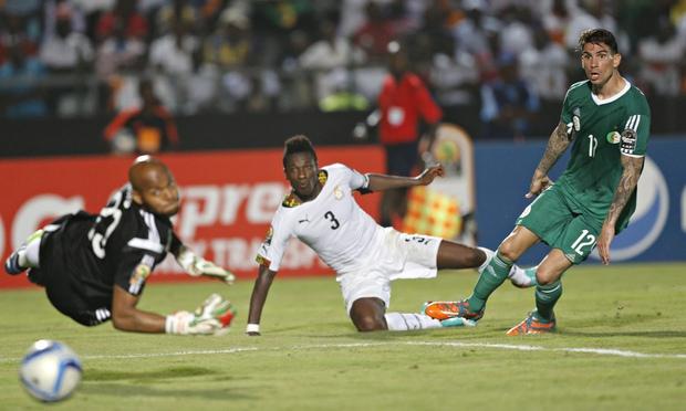Algeria's Carl Medjani and Rais Adi Mbolhi can only look on as Ghana's Asamoah Gyan scores the winni