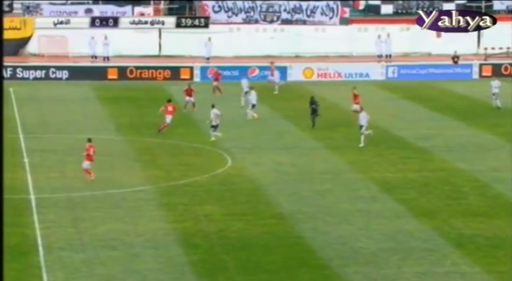 Ghaly moves towards player in possession to win the ball back.