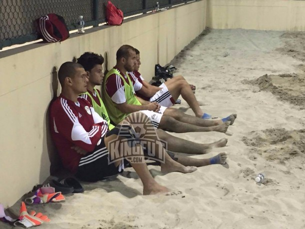 El-Sayed sitting with Egypt's substitutes in preparation for the friendly game in Bahrain