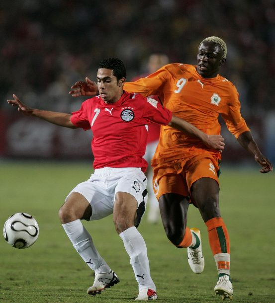 CAIRO, EGYPT - FEBRUARY 10: Wahab Abdel Mohamed of Egypt and Arouna Kone of the Ivory Coast are show in action during the African Cup of Nations Final at Cairo International Stadium February 10, 2006 in Cairo, Egypt. (Photo by Ben Radford/Getty Images)