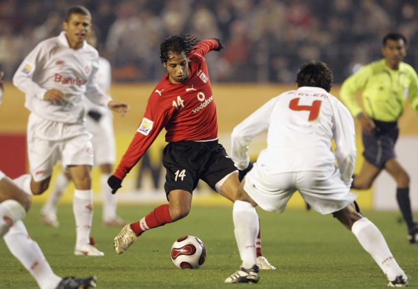 TOKYO, JAPAN - DECEMBER 13: Hassan Mostafa of Ahly Sporting Club in action during the FIFA Club World Cup Japan 2006 Semifinals between Sport Club Internacional and Ahly Sporting Club at the National Stadium on December 13, 2006 in Tokyo, Japan. (Photo by Junko Kimura/Getty Images)