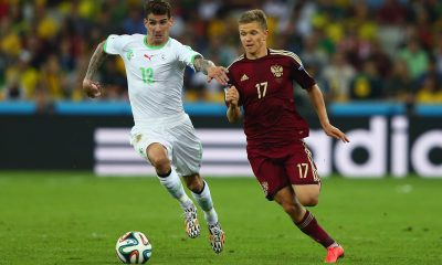 Carl Medjani of Algeria challenges Oleg Shatov of Russia