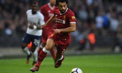 LONDON, ENGLAND - OCTOBER 22: Mohamed Salah of Liverpool runs with the ball during the Premier League match between Tottenham Hotspur and Liverpool at Wembley Stadium on October 21, 2017 in London, England.