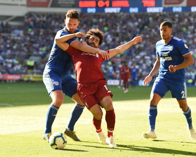 Mohamed Salah helps Liverpool return top after victory over Cardiff City